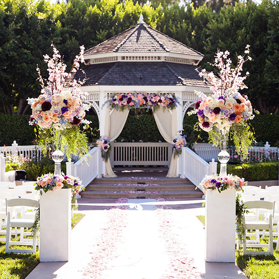 Tips for choosing floral arrangements for your disneyland for Outdoor wedding gazebo decorating ideas