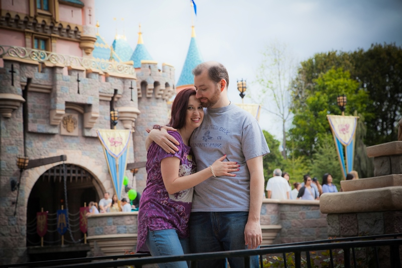 Couple posing in front of Sleeping Beauty Castle