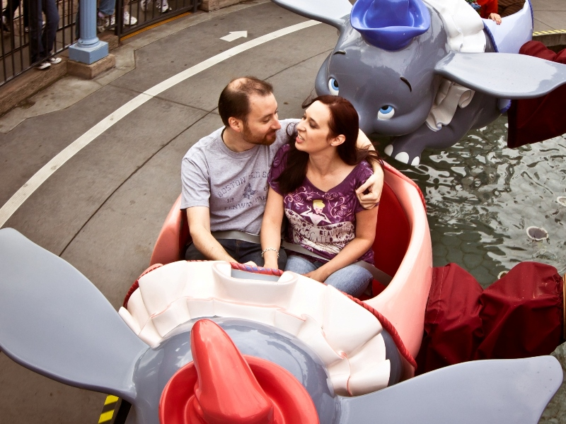 Couple riding Dumbo attraction at Disneyland