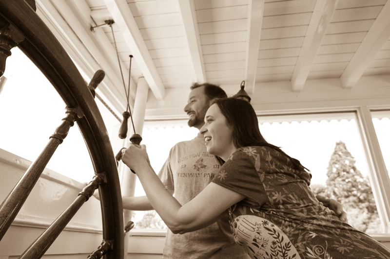 Couple posing in wheelhouse of Mark Twain