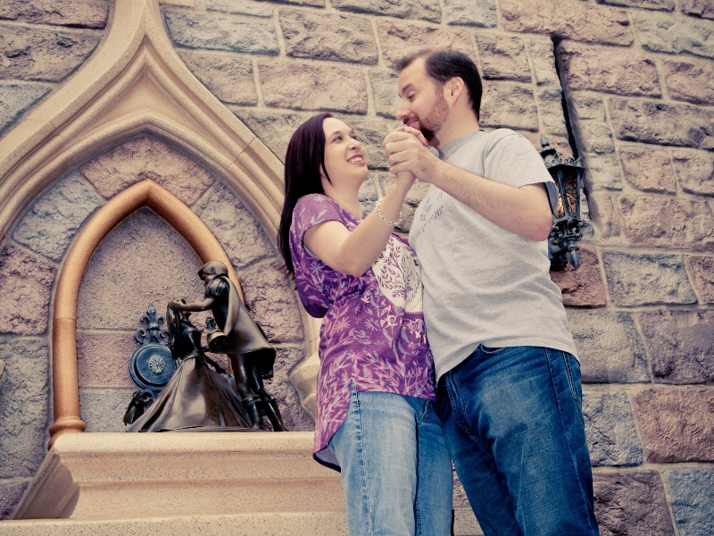 Couple posing at Sleeping Beauty statue