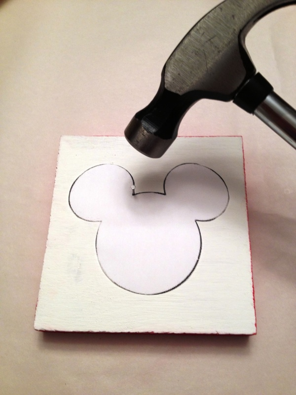 Wood block with Mickey shape template and hammer