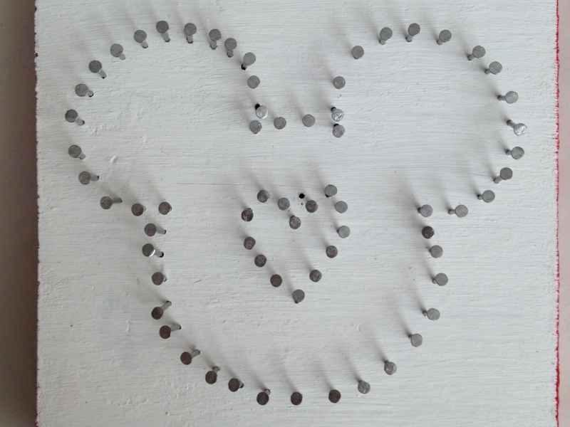 Mickey shape with nails outline and heart in the center