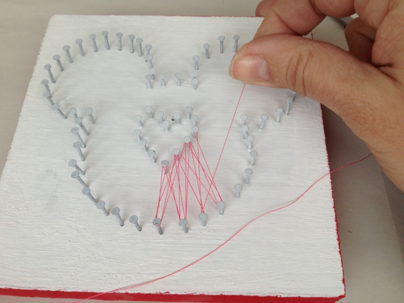 Mickey shape with nails and string criss crossing through the nails