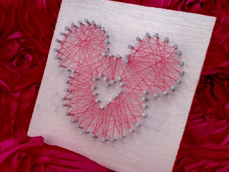 Completed string art Mickey shape with heart