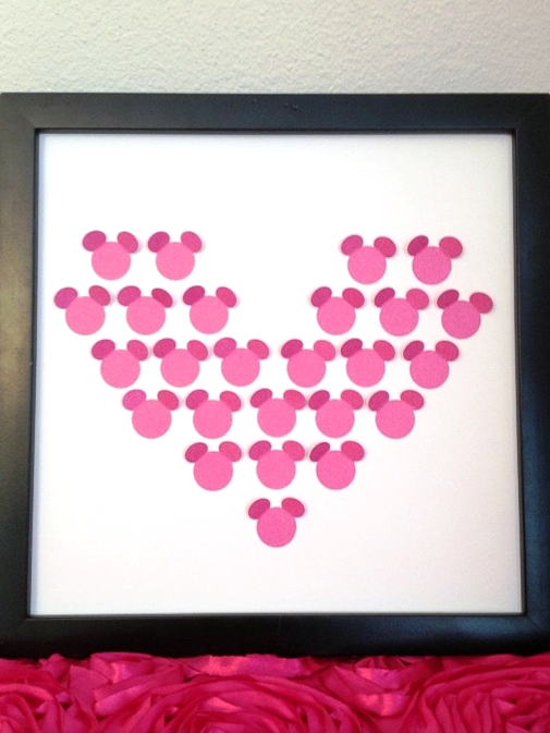 Heart made with paper Mickey shapes