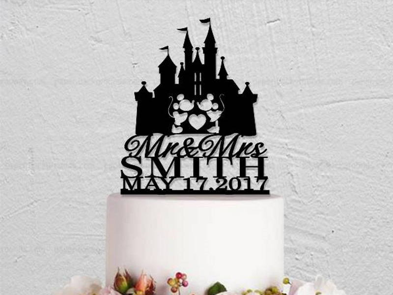 White cake with black iron cake topper in the shape of a castle