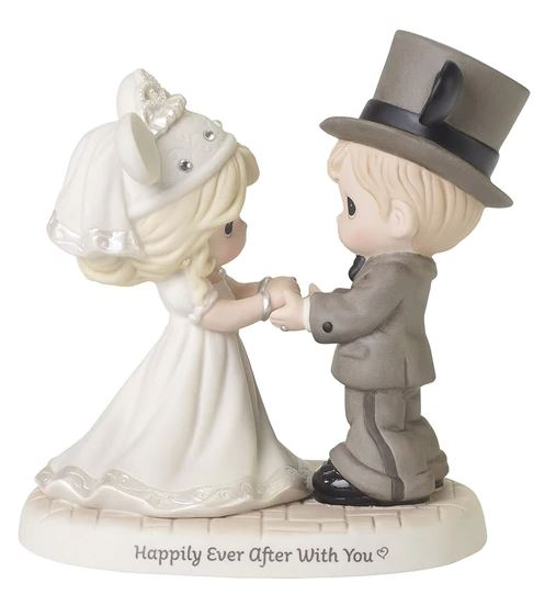 Precious Moments brand figurine of bride and groom wearing Disney Mickey Mouse ear hats