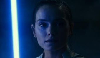 Rey with blue lightsaber in STAR WARS: THE RISE OF SKYWALKER