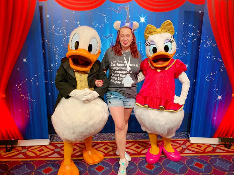 Blogger Mindy Marzec with Donald and Daisy at the Disney's Fairy Tale Weddings Showcase at The Disneyland Hotel