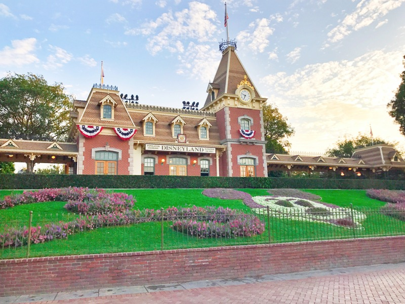 Disneyland train station sitting behind Mickey floral mural