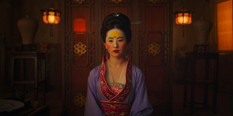 Mulan dressed in purple robe and makeup