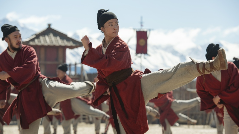 Mulan in warrior training, kicking her leg in a fighting pose