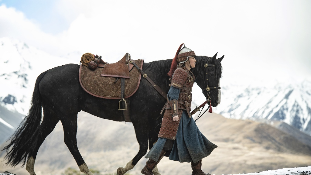 Mulan in warrior armor, walking alongside her black horse