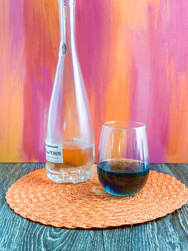 Glass of rose wine with blue food coloring