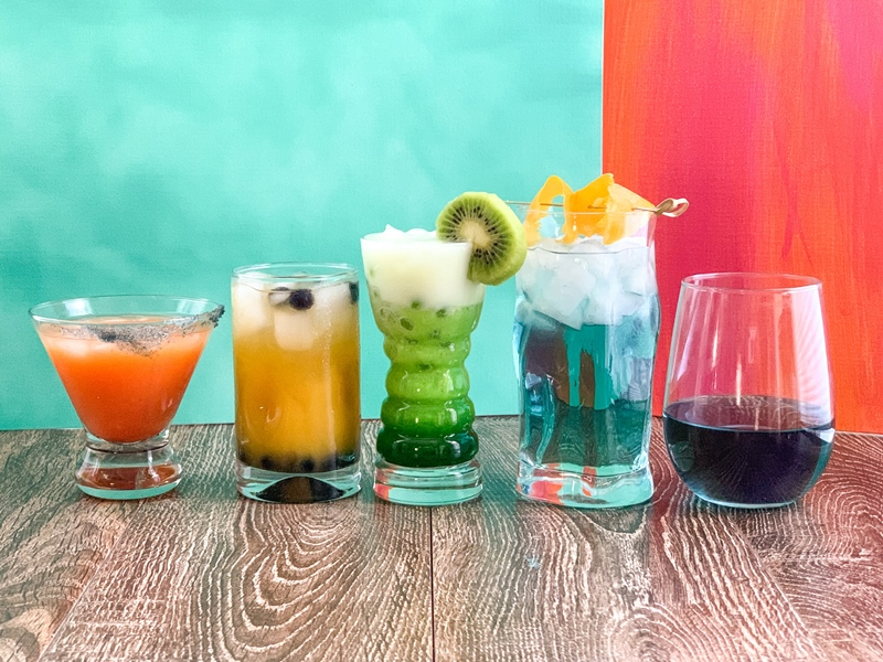 Five different color cocktails in a row