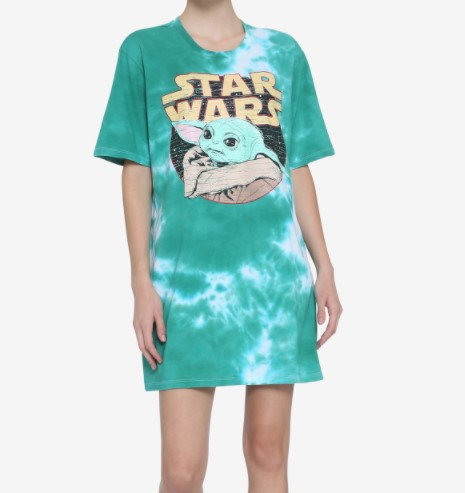 Woman wearing tie dye shirt dress featuring The Child from The Mandalorian