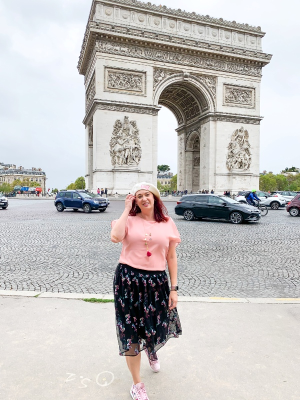 Woman in front of Arc de Triumph