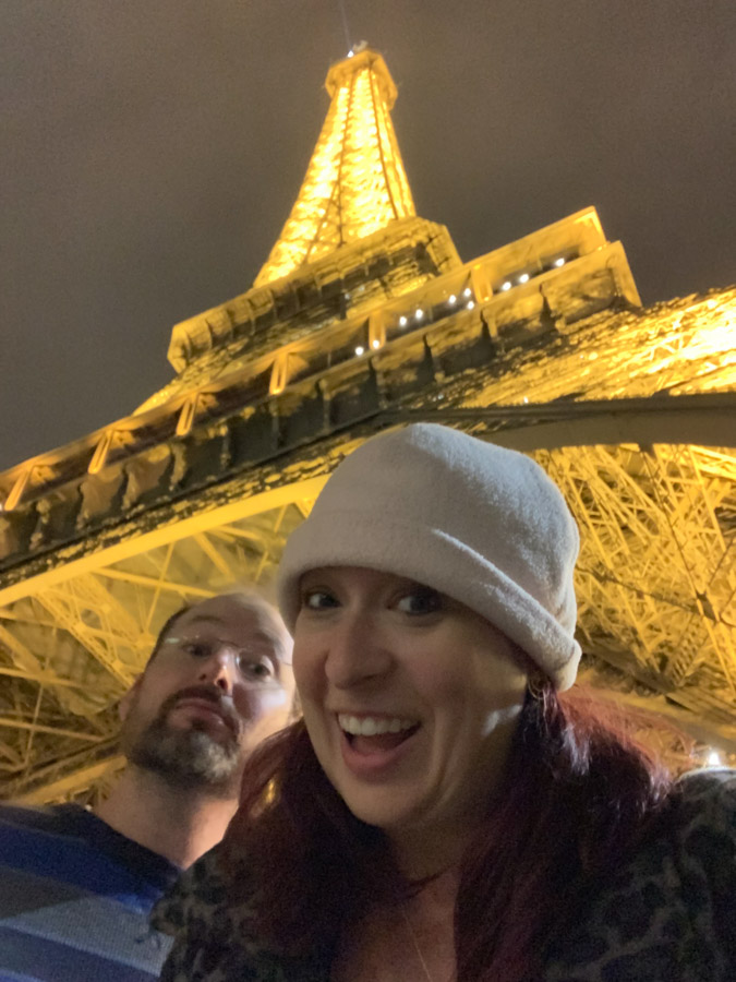Selfie in front of Eiffel Tower at night