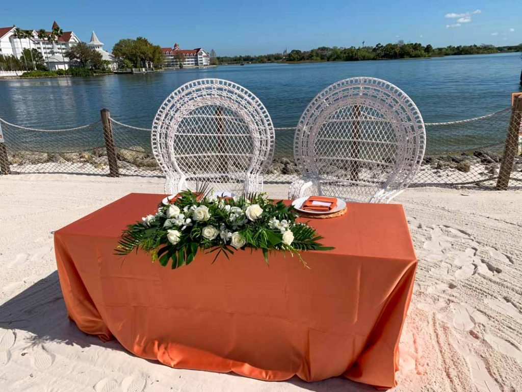 Close up of wedding head table on the beach