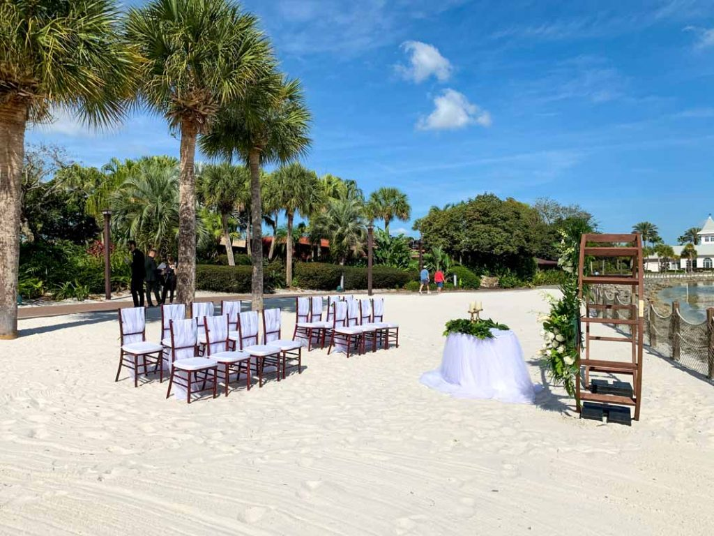 wedding ceremony at luau beach at disney's polynesian resort