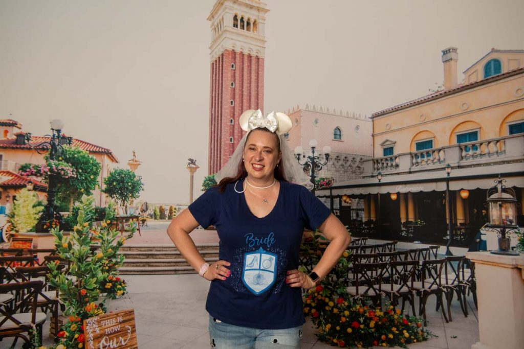 Woman in front of backdrop of Italy World Showcase at EPCOT