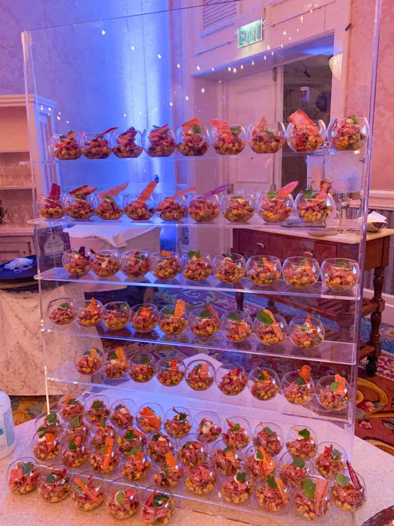 acrylic wall holding appetizers