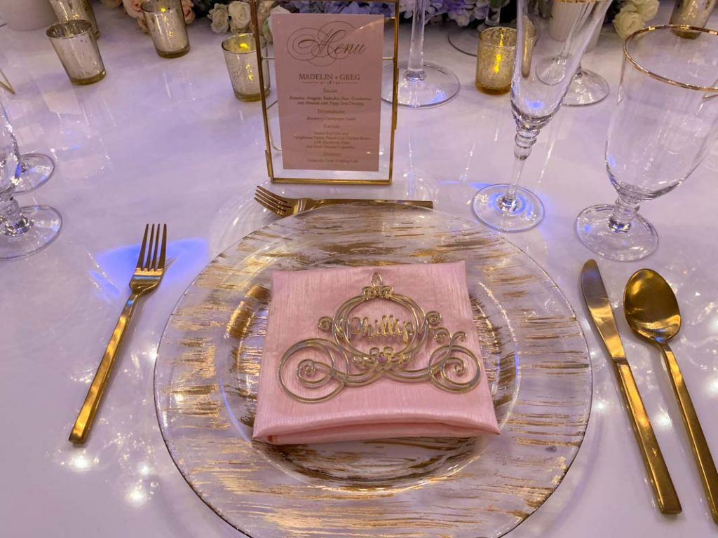 Close up of reception table setting with carriage shaped place card