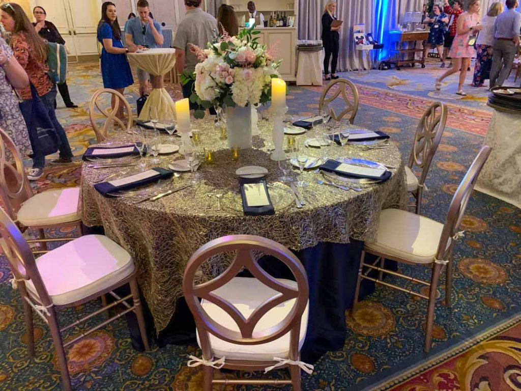 Table with gold tablecloth and 8 chairs