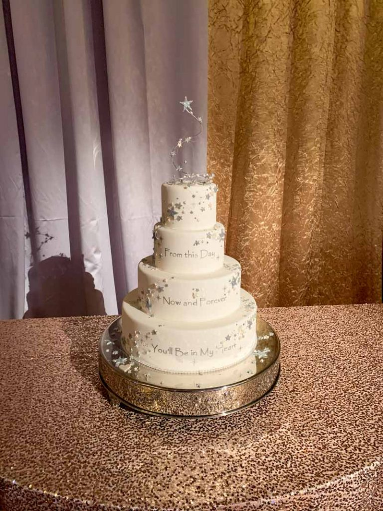 White wedding cake with four tiers and silver icing