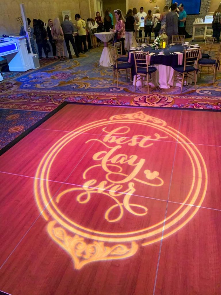 "Dance floor with gobo light that reads ""best day ever"""
