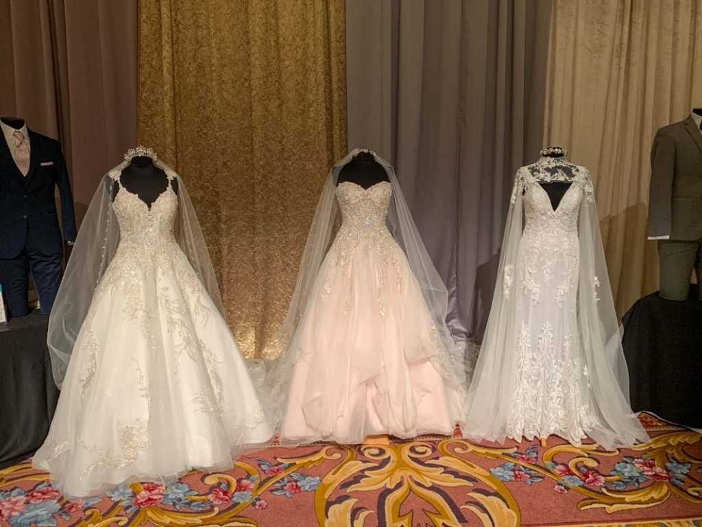 Three mannequins with bridal gowns
