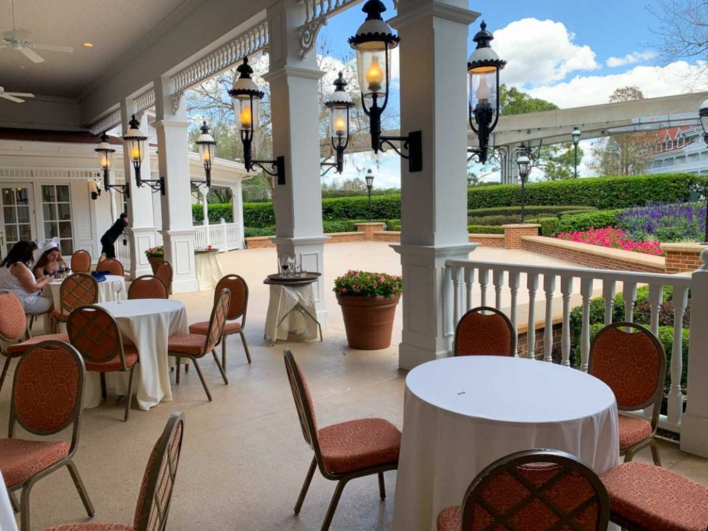 Patio at Disney's Grand Floridian Hotel with small tables and chairs