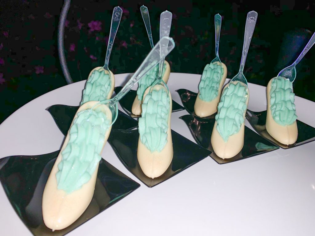 dessert of white chocolate in the shape of glass slipper with blue cream