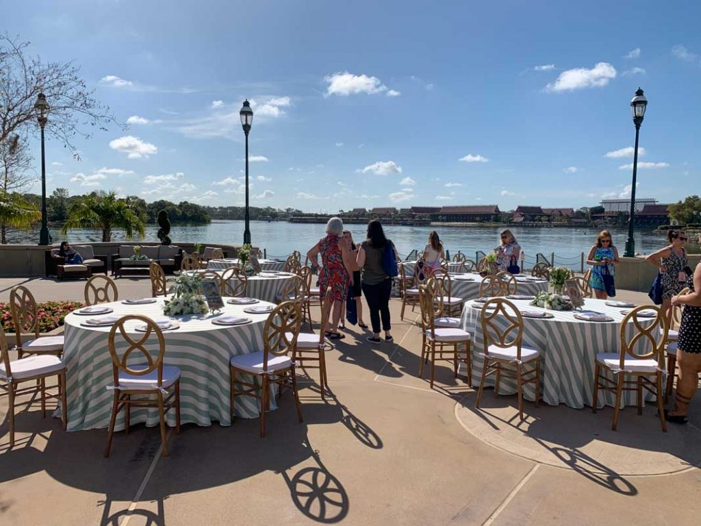 Wide shot of wedding reception tables at summerhouse patio