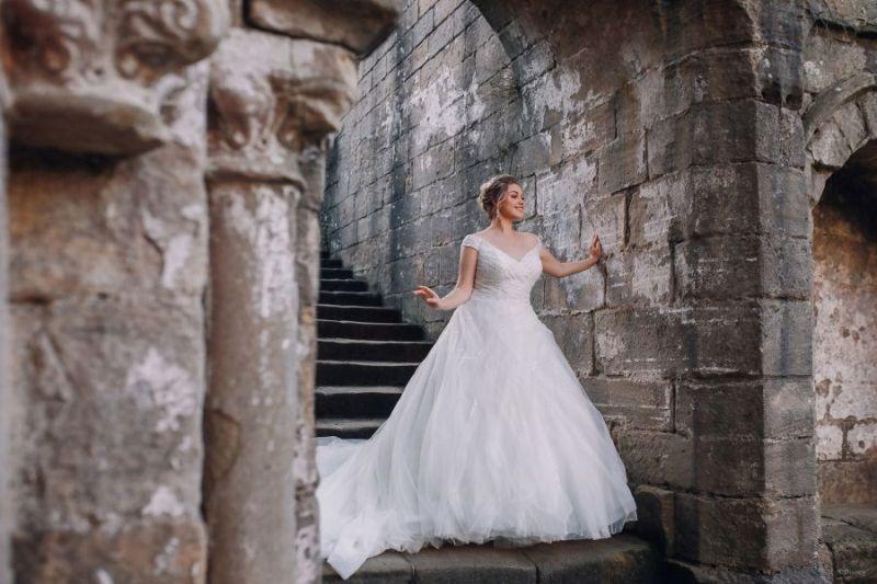Bride wearing wedding gown inspired by Disney Princess Cinderella
