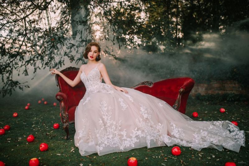 Bride wearing wedding gown inspired by Disney Princess Snow White