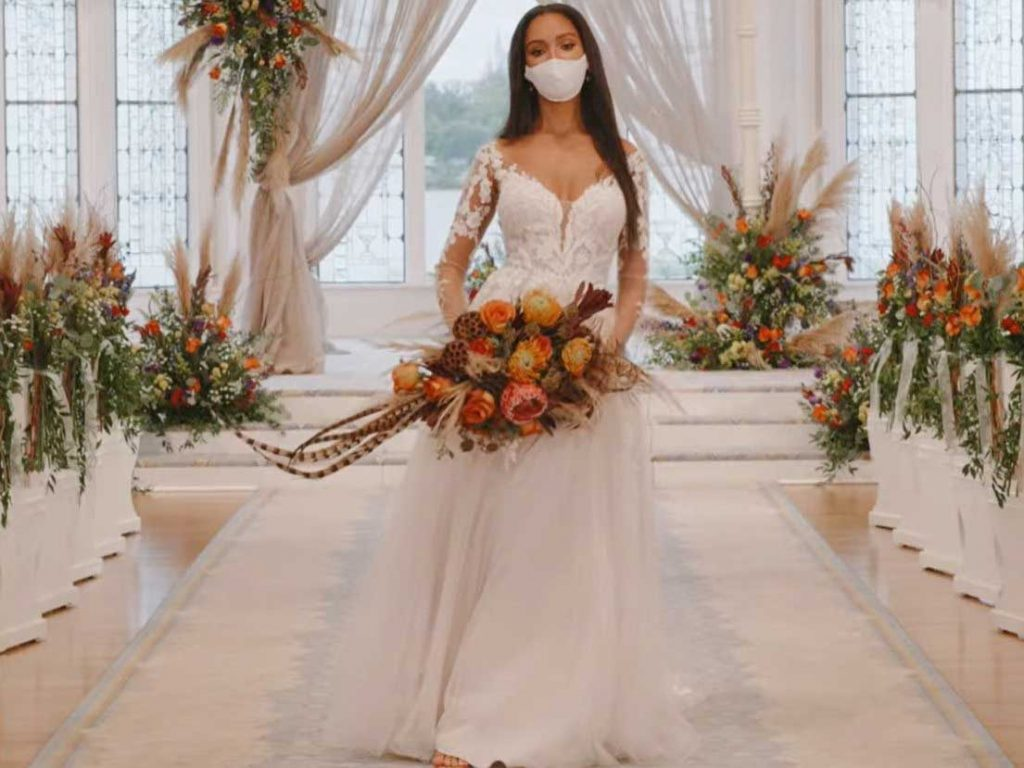 Woman wearing wedding gown inspired by Pocahontas