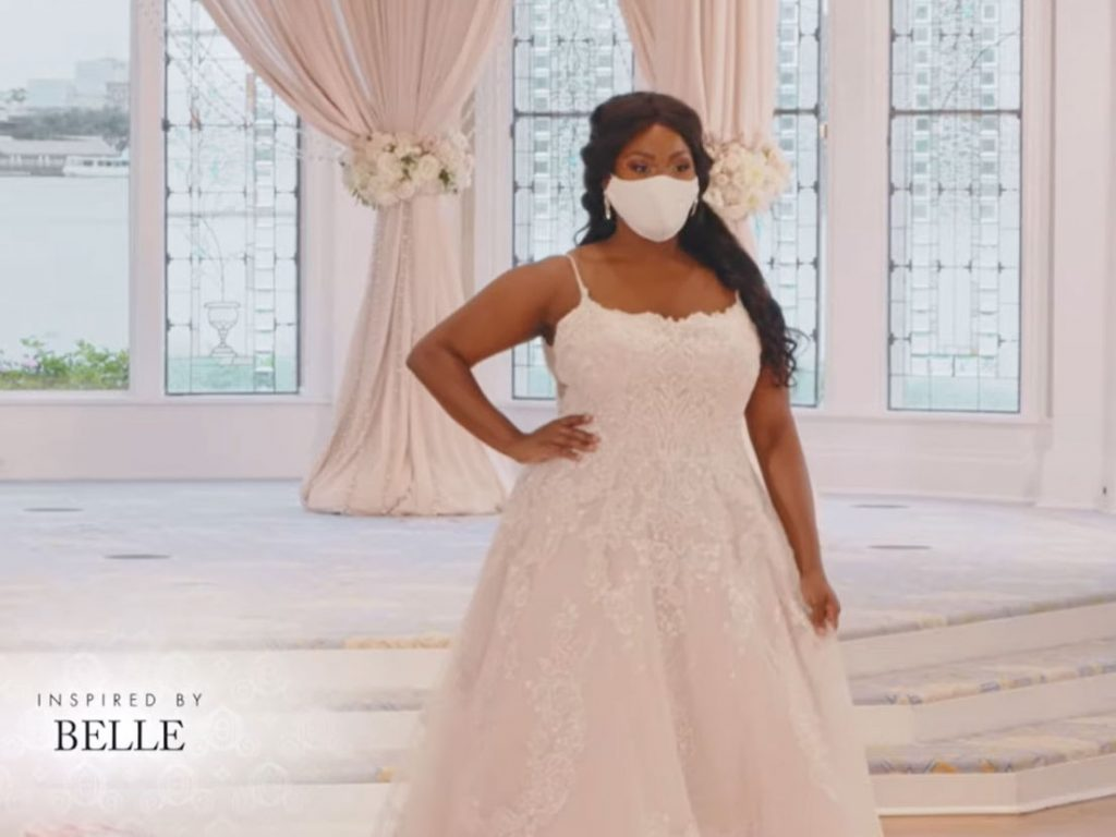 Woman wearing wedding gown inspired by Belle