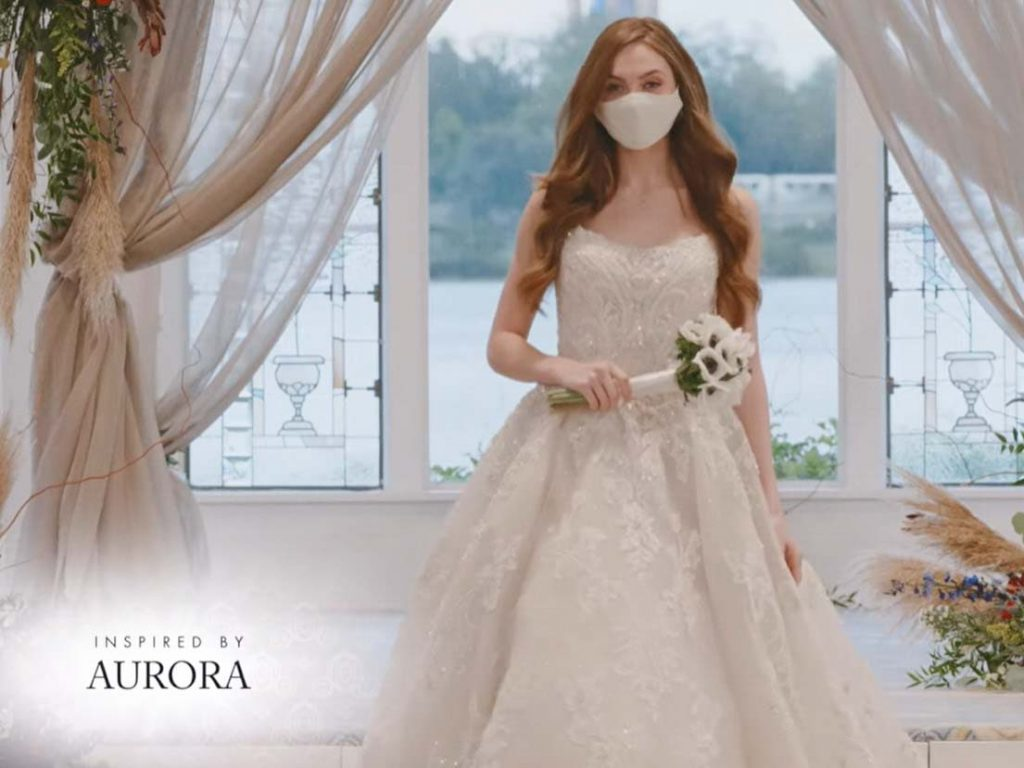 Woman wearing wedding gown inspired by Aurora