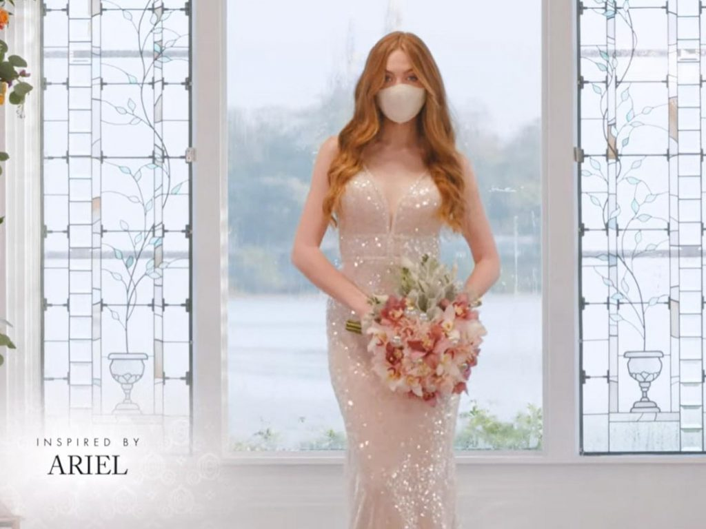 Woman wearing wedding gown inspired by Ariel