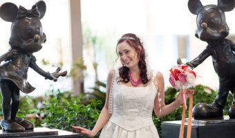Bride with Mickey Mouse and Minnie Mouse statues at The Disneyland Hotel