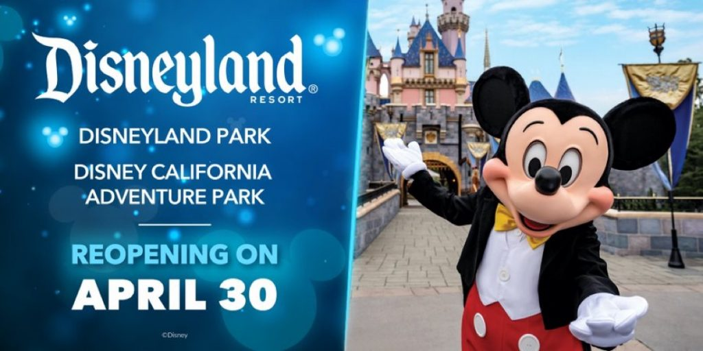 Mickey Mouse standing in front of Sleeping Beauty Castle at Disneyland