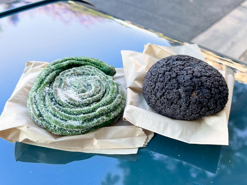 Green spiral churro and purple cream puff from Terran Treats