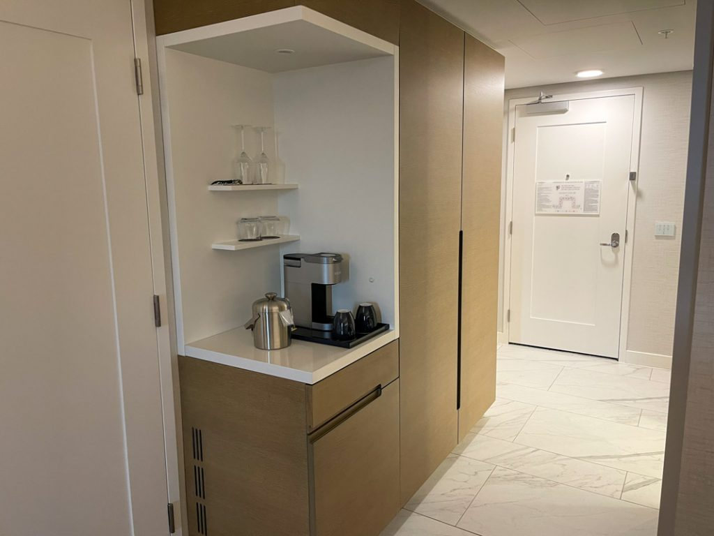 Interior of Westin Anaheim hotel room showing coffee maker and closet