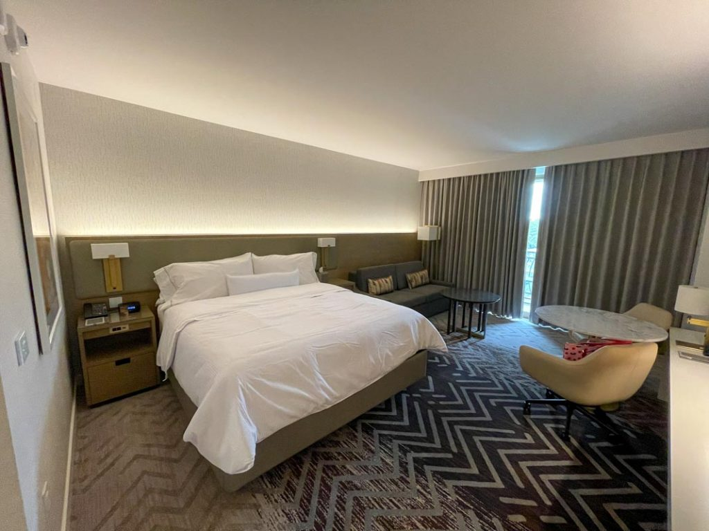 Interior of Westin Anaheim hotel room showing King bed and sofa