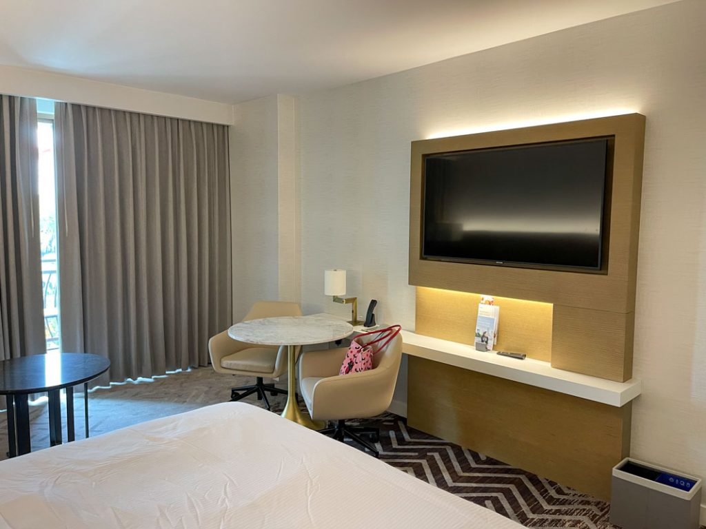 Interior of Westin Anaheim hotel room showing TV and table and chairs