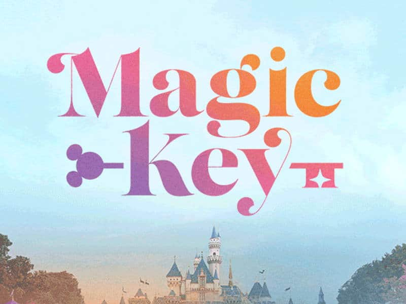 """Blue sky with the words """"Magic Key"""" in rainbow colors"""